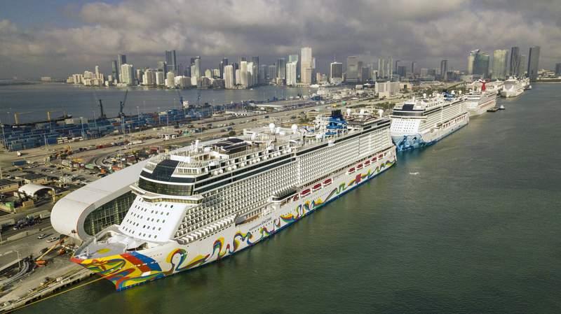 The Norwegian Encore cruise ship is docked at the Port of Miami on Thursday, March 26, 2020, in Miami, Fla. (Al Diaz/Miami Herald via AP)