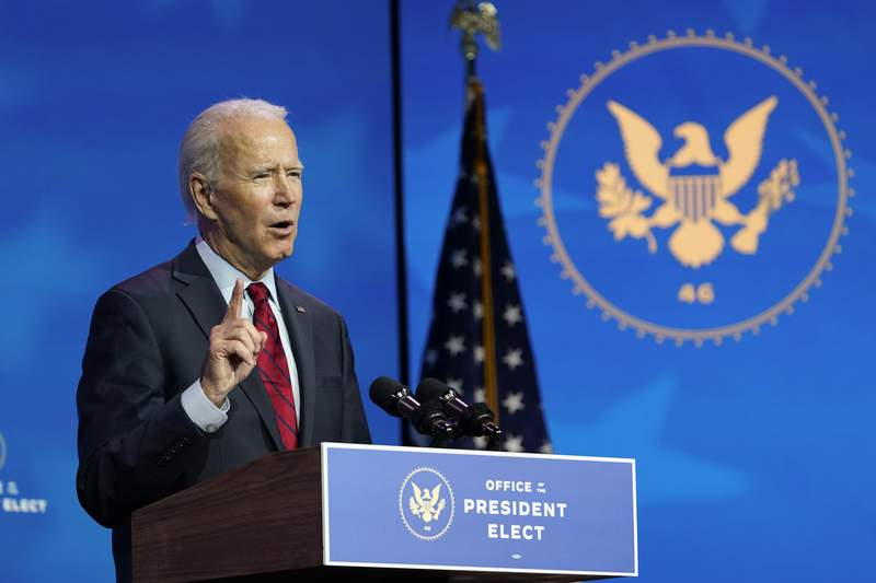 President-elect Joe Biden speaks during an event at The Queen theater in Wilmington, Del., Tuesday, Dec. 8, 2020, to announce his health care team. (AP Photo/Susan Walsh)