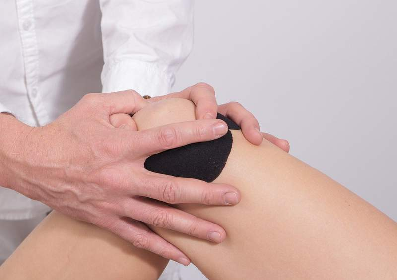 A person gets their knee worked on.