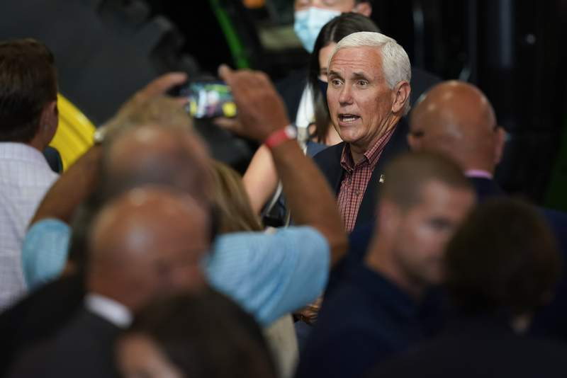 FILE - In this Aug. 13, 2020, file photo Vice President Mike Pence greets audience members during the Farmers & Ranchers for Trump Coalitions launch in Des Moines, Iowa. The White House says the president and vice president observe federal health guidelines, as well as those in place in the states they visit. Trips are planned with input from the presidential medical staff. (AP Photo/Charlie Neibergall, File)