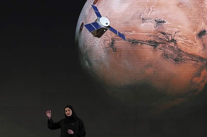"""FILE - In this Wednesday, May 6, 2015 file photo, Sarah Amiri, deputy project manager of a planned United Arab Emirates Mars mission talks about the project named """"Hope,"""" """"Amal"""" in Arabic, during a ceremony in Dubai, United Arab Emirates. (AP Photo/Kamran Jebreili)"""