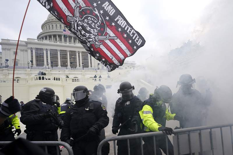 FILE - In this Jan. 6, 2021, file photo police hold off supporters of Donald Trump who tried to break through a police barrier at the Capitol in Washington. House Speaker Nancy Pelosi has told Democratic colleagues that she will create a new committee to investigate the Jan. 6 insurrection at the Capitol. (AP Photo/Julio Cortez, File)