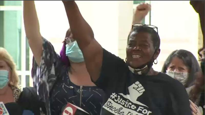 """Cynthia Byrd Green chants """"No Justice, No Peace,"""" with members of Justice Brevard"""
