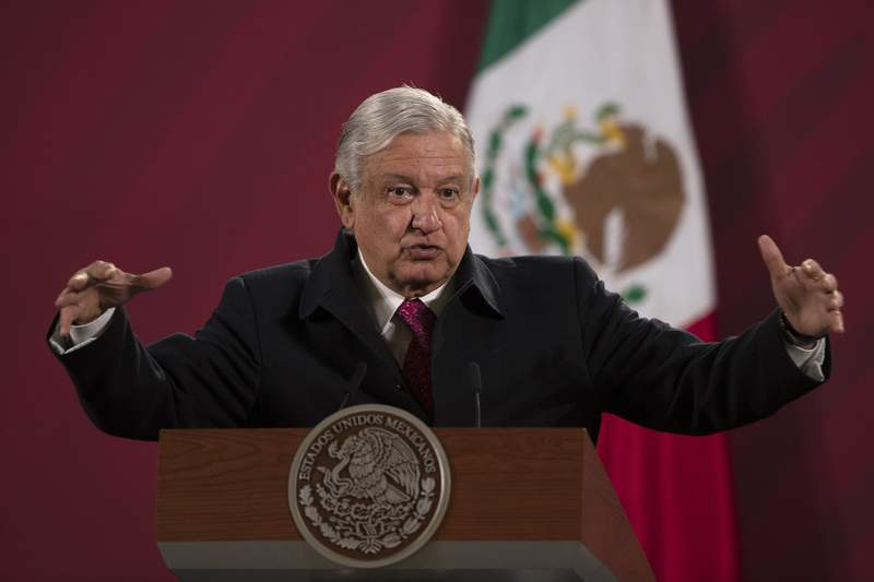 FILE - In this Dec. 18, 2020 file photo, Mexican President Andres Manuel Lopez Obrador gives his daily, morning news conference at the presidential palace, Palacio Nacional, in Mexico City. Mexico President Andrs Manuel Lpez Obrador says he has tested positive for COVID-19 and is under medical treatment, Sunday, Jan. 24, 2021. (AP Photo/Marco Ugarte, File)