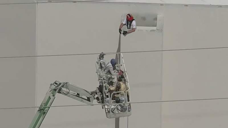 Orange County firefighters work to rescue construction workers stuck 40 feet in the air