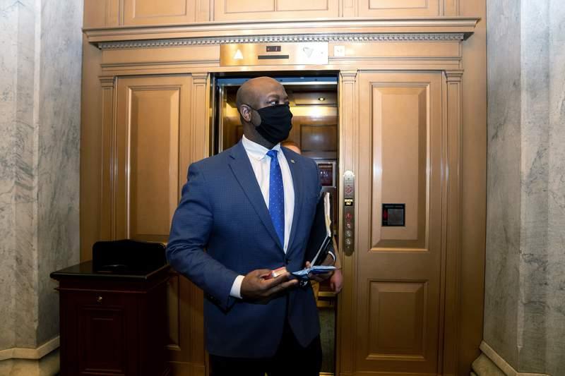 FILE - In this Feb. 13, 2021, file photo, Sen. Tim Scott, R-S.C., departs Capitol Hill in Washington. Scott will deliver Republicans rebuttal to President Joe Bidens joint address to Congress. (Stefani Reynolds/Pool via AP, File)
