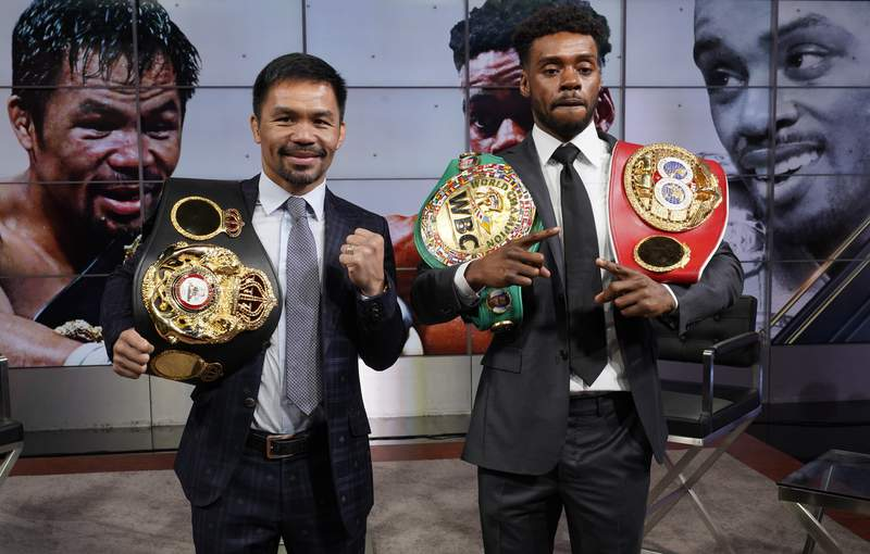 Manny Pacquiao, left, and Errol Spence Jr., pose for a photo at a news conference at the Fox Studios lot in Los Angeles ahead of their upcoming boxing match, taking place in Las Vegas on Aug. 21, in Los Angeles Sunday, July 11, 2021. (AP Photo/Damian Dovarganes)