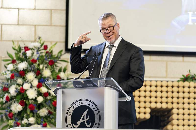 """Chipper Jones, former Atlanta Braves player and Hall of Famer, speaks during """"A Celebration of Henry Louis Aaron,"""" a memorial service celebrating the life and enduring legacy of the late Hall of Famer and American icon, on Tuesday, Jan. 26, 2021, at Truist Park in Atlanta. (Kevin D. Liles/Atlanta Braves via AP, Pool)"""